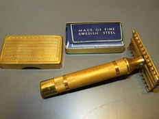 Former gold-plated Gilette razor and its storage box.