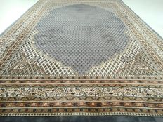 "Mir – 297 x 204 cm. – ""Modern Oriental rug in baby blue - in beautiful, near mint condition""."