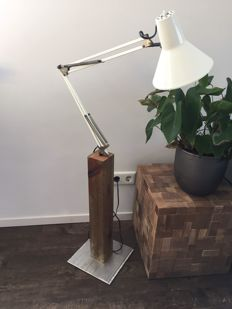 Vintage architects lamp on a wooden stand.