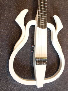 Silent guitar with steel strings, white with cable and headphones
