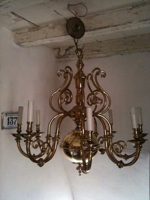 Large antique eight-light brass chandelier, mostly cast brass, Italy, first half of the 20th century
