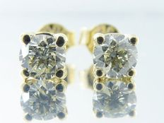 Yellow gold solitaire ear studs set with cut diamonds, 0.64 ct in total ***no reserve***