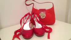 Stuart Weitzman/Bruno Magli. Handbag and elegant sandals.