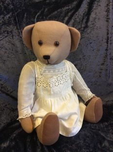 Decorative teddy bear with beautiful old lace blouse and apron