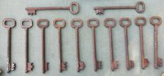 Lot of 13 antique iron keys from a monastery, 17th century, Italy