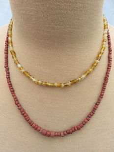 Late medieval necklaces with yellow glass and stone beads - 43 cm and 52 cm. (2)
