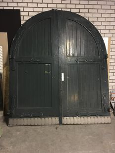 A double stable door with wrought iron reinforcements - the Netherlands - ca. 1940