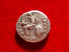 Roman Republic - N. Fabius Pictor silver denarius (3,88 g. 17 mm.) - Rome, 126 B.C. Fabius Pictor seated on shield inscribed QVI / RIN. mint mark O. Rare.