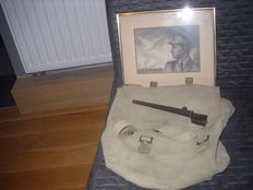 Nice lot ww2 a  military English backpack, a English nail bayonet and its sheath and an original drawing in charcoal over liberation of city of Antwerp signed C Sielens