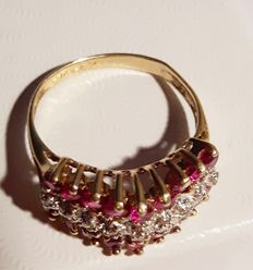 585 gold ring 3 g with white diamonds and rubies