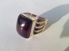 Heavy solid silver ring with a large amethyst
