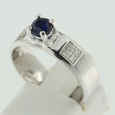 14 kt white gold band ring set with brilliant cut sapphire and diamond