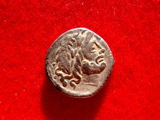 Roman Republic - Vettia silver quinarius  (1,76g. 14 mm.) minted in Rome, 99 B.C. Victory crowning trophy. S