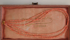 3-row necklace of angel skin coral