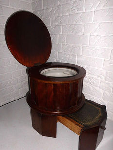 Old fashioned toilet in wooden enclosure with leather and earthenware bowl, unique antique item, England, 1st half 20th century