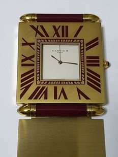 CARTIER. Travel clock with alarm, from the 1980s.