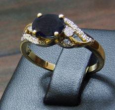 18k Yellow gold and 1.54 Blue natural Sapphire set 054ct diamonds