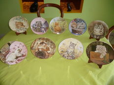 Collection of plates with paintings of cats