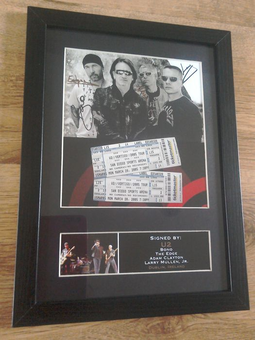 U2  photograph with autographs ( printed ) in frame.