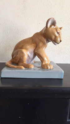 French Blazek - A ceramic sculpture of a young lion