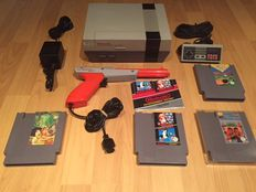 Nes Console Action Set Fully Complete with original Controller and Light Gun,Mario/Duckhunt with manual, Dragon Ninja and others