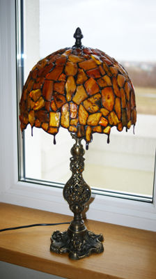 The large amber light, full of large pieces of amber, natural light, precise manual work.  3100 grams