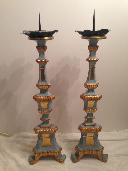 A large pair of Baroque carved and parcel gilt wood pricket candlesticks - Italy - first half 18th century