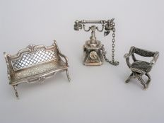 Three silver miniatures,  including H. Hooijkaas