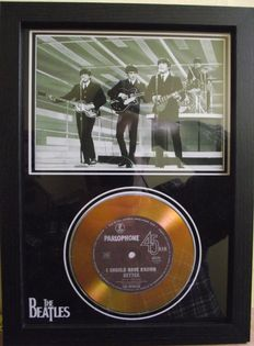 The Beatles, photo and gold disc effect presentation.for their song; 'I Should have Known Better'. Parlophone Record label.