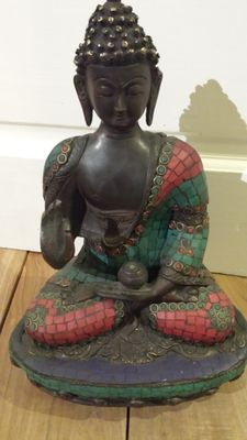 A seated Buddha - Nepal - late 20th century