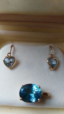 18 kt gold pendant with Santa Maria aquamarine. 18 kt gold sleeper earrings with aquamarines.