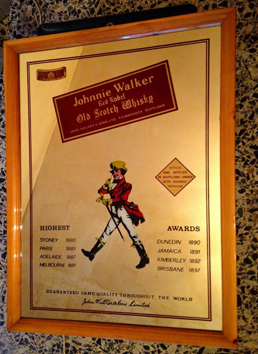 Two vintage advertising frames mirror Johnnie Walker and Beefeater