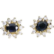 Yellow gold ear studs each set with sapphire and zirconia stones.