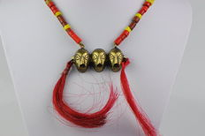 Necklace from the Naga tribe from Myanmar - glass beads and pendant made of brass