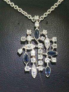White gold pendant with diamonds and sapphires