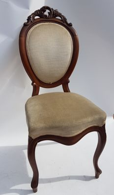 Isabelline style chair, made of mahogany, with a handmade floral carving, 1950