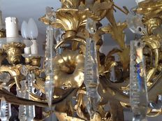 A gilt bronze 20-light chandelier with cut crystal pendants - 19th century