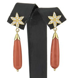 Yellow gold earrings with  natural Pacific coral, star motif and set zircons.