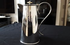 Silver plated table serving jug, engraved with the flag of the White Star Line shipping company.