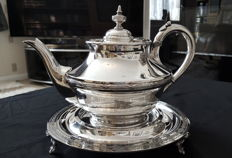 Silver plated teapot & stand. Teapot is engraved with the flag of the White Star Line shipping company.