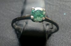 White gold ring with green diamond