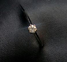 White gold solitaire engagement ring with diamond.