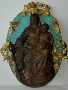 A carved wood group of Madonna with Child and Saint John at her feet - Italy - 19th century