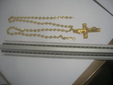 Gold necklace with pendant.