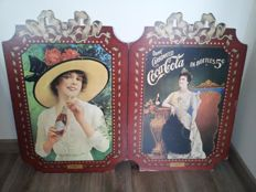 Two large cardboard signs Coca Cola-second part of the 20th century
