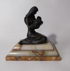 Bronze statue on marble base of a mother with child