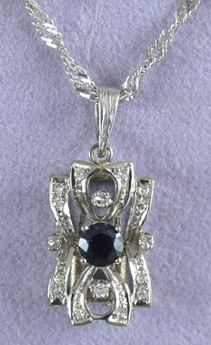 Pendant, 18 kt, with sapphire and 0.24 ct diamond with necklace.