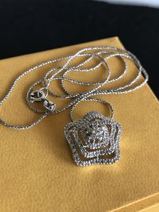 18 kt gold necklace with pendant with 1 ct diamonds.