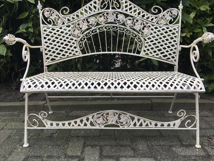 A Wrought Iron And Cast Iron Garden Bench   Ca. 1970