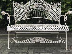 A wrought-iron and cast-iron garden bench - ca. 1970